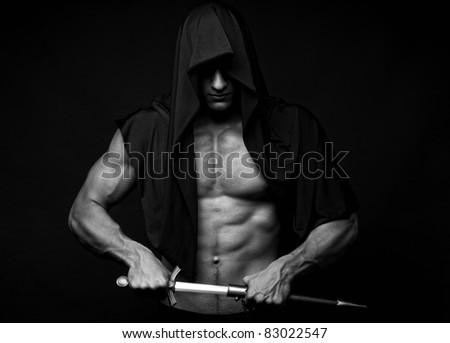 Muscled male model with a short sword - stock photo