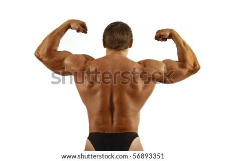 Muscled model posing.Isolated on white background - stock photo