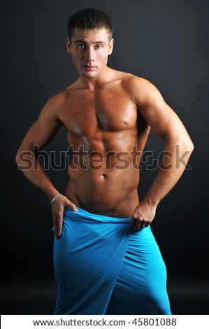 Muscled model with a blue textile