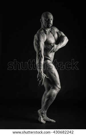 Muscled on a black background