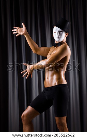 Muscular actor with theatrical mask - stock photo