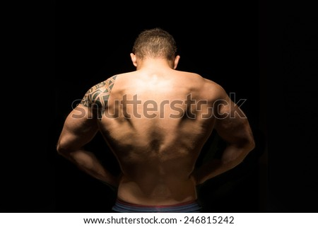 Muscular and huge back muscular with typical body building pose - stock photo