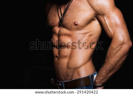 Muscular and sexy torso of young man with perfect abs - stock photo