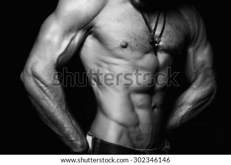 Muscular and sexy torso of young man with perfect abs. Black and white