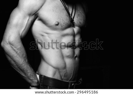 Muscular and sexy torso of young man with perfect abs. Black and white photo - stock photo