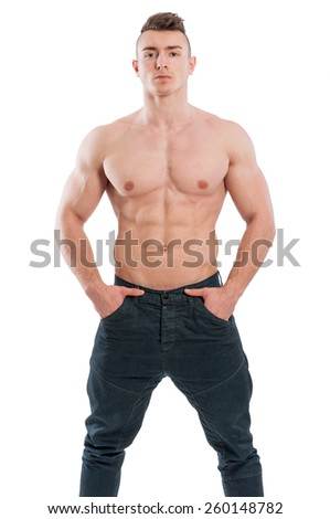 Muscular and shirtless male model standing isolated on white background - stock photo