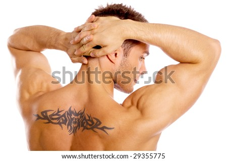 Muscular and tanned male with tattoo isolated on white - stock photo