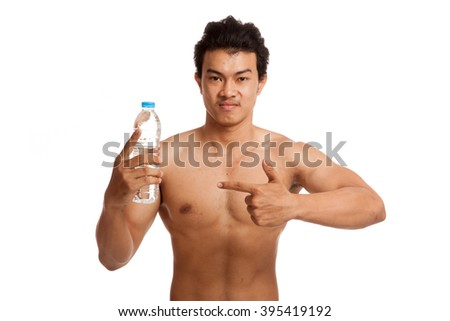 Muscular Asian man point to bottle of drinking water  isolated on white background