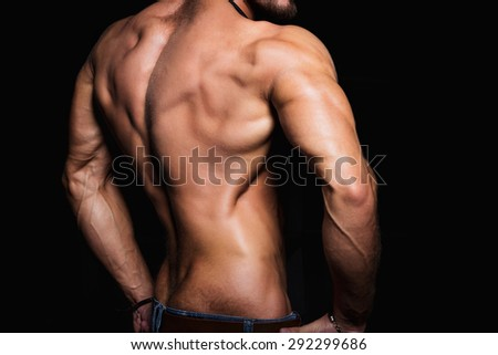 Muscular back and sexy torso of young man. Perfect back muscles and triceps. - stock photo