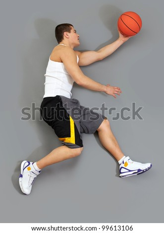 Muscular basketball player catching the ball, overview - stock photo