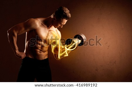 Muscular body builder lifting weight with energy lights on biceps concept - stock photo