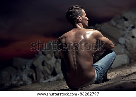 Muscular body of an handsome bodybuilder - stock photo