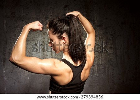 Muscular body with perfect abs/Strong woman - stock photo