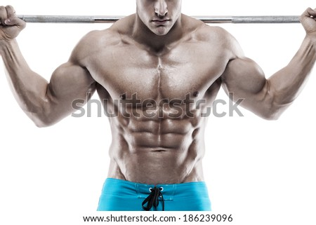 Muscular bodybuilder guy doing exercises with dumbbell over white background - stock photo