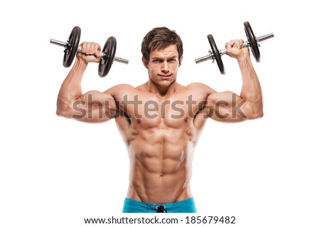 Muscular bodybuilder guy doing exercises with dumbbells over white background - stock photo
