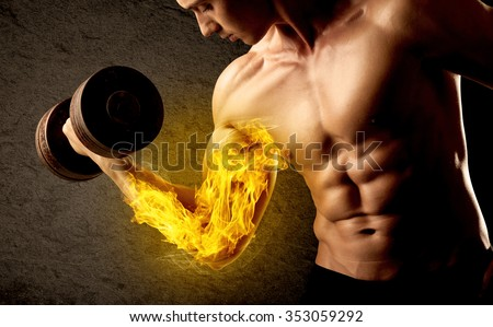 Muscular bodybuilder lifting weight with flaming biceps concept on background - stock photo
