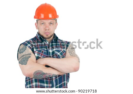 Muscular caucasian building contractor with tattoos with his arms crossed, isolated over a white background, copyspace - stock photo