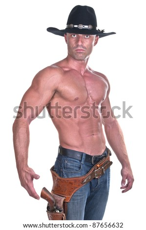 muscular cowboy with gun on white background - stock photo