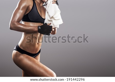 muscular fit woman finishing the exerce - stock photo