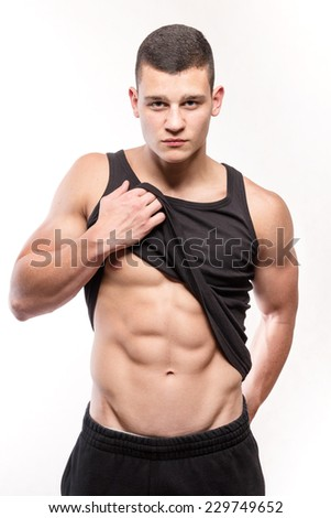 Muscular fitness man torso with six-pack - studio shoot - stock photo