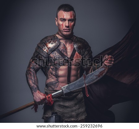 Muscular gladiator in armor with sword