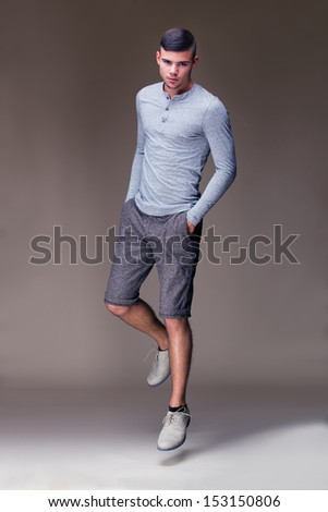Muscular handsome man jumping in elegant dress - stock photo