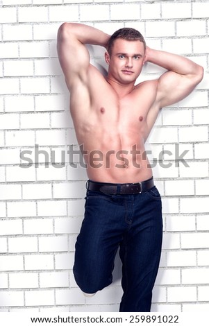 Muscular handsome man posing in studio.