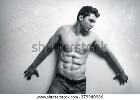 Muscular handsome man with sexy abs - stock photo