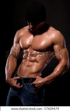 Muscular male body  on black background. - stock photo
