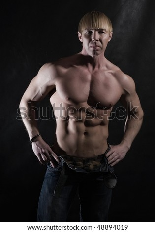 Muscular male bodybuilder In a black background in studio