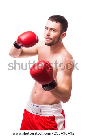 Muscular male boxer ready to fight with boxing gloves in a combat - stock photo