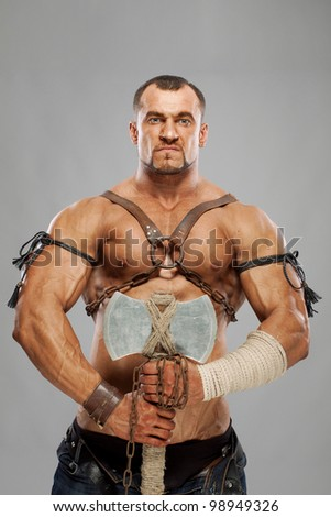 muscular male portrait of ancient warrior with axe