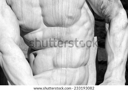 muscular man body- detail of Hercules and Cacus statue  by Baccio Bandinelli on  Piazza della Signoria in Florence, Italy - stock photo