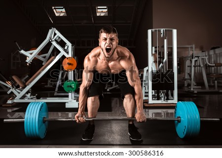 Muscular Man Doing Heavy Deadlift Exercise - stock photo
