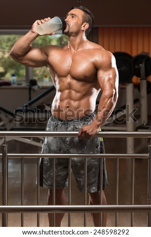Muscular Man Drinking A Water Bottle - stock photo