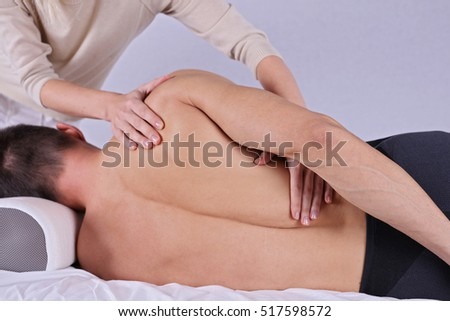 Muscular Man having sport massage. Acupressure, Chiropractic, osteopathy, concept .