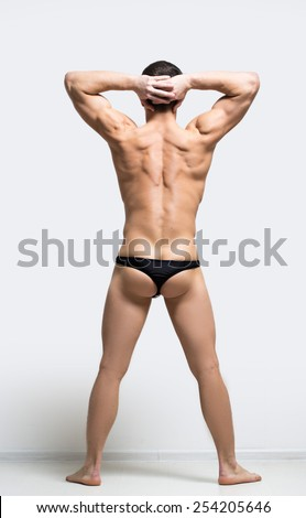muscular man in a thong - stock photo