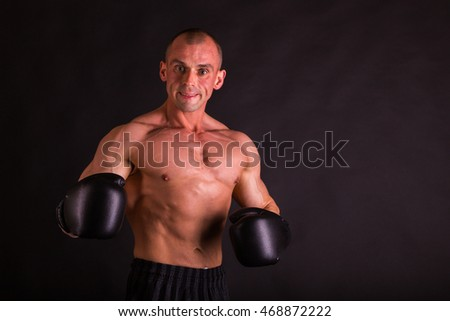 Muscular man in boxing gloves