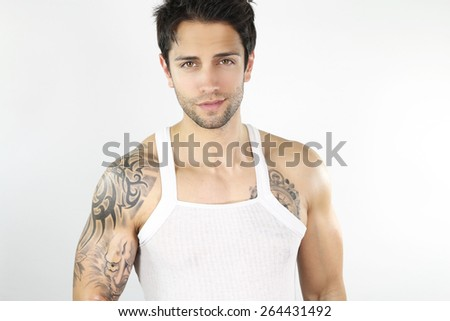 muscular man in tank top smiling
