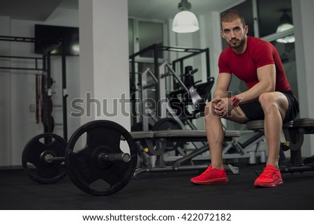 Muscular Man in The Gym - stock photo