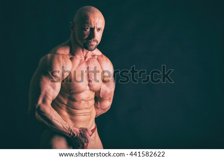 Muscular man on black