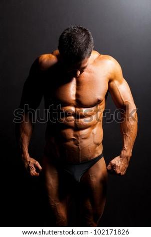 muscular man's body in studio light - stock photo
