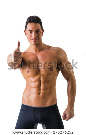 Muscular man shirtless doing thumb up sign for OK, smiling at camera, isolated on white - stock photo