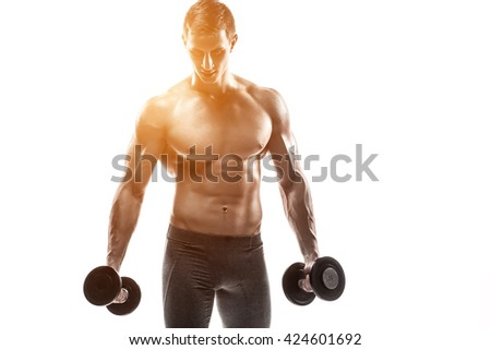 Muscular man showing perfect body with dumbbells, isolated on white - stock photo