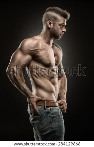 Muscular man - side view - on black background - stock photo