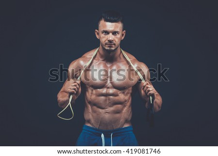 Muscular man skipping rope. active  sport  fitness