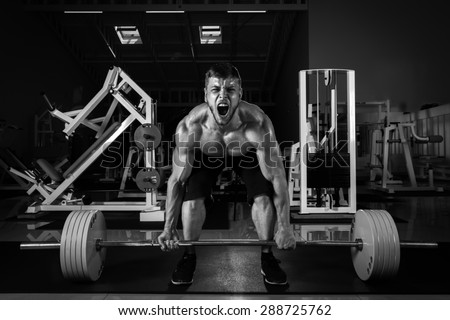 Muscular Men Lifting Deadlift In The Gym - stock photo