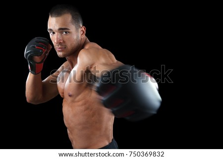 Muscular mma fighter punching