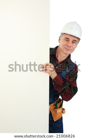 Muscular professional man in a builder uniform with board. - stock photo
