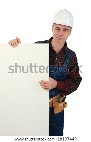 Muscular professional man in a builder uniform with tools. - stock photo